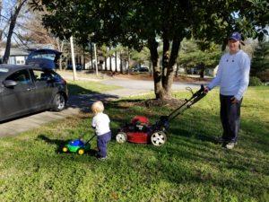 My son pushing his mower while I push mine