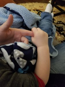 My son holding my finger