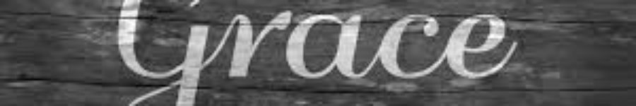 Image of the word grace on hardwood background