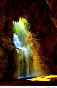 A picture of a waterfall in a cave