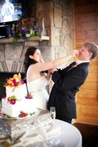 Picture of my wife and I shoving cake in each others mouth.