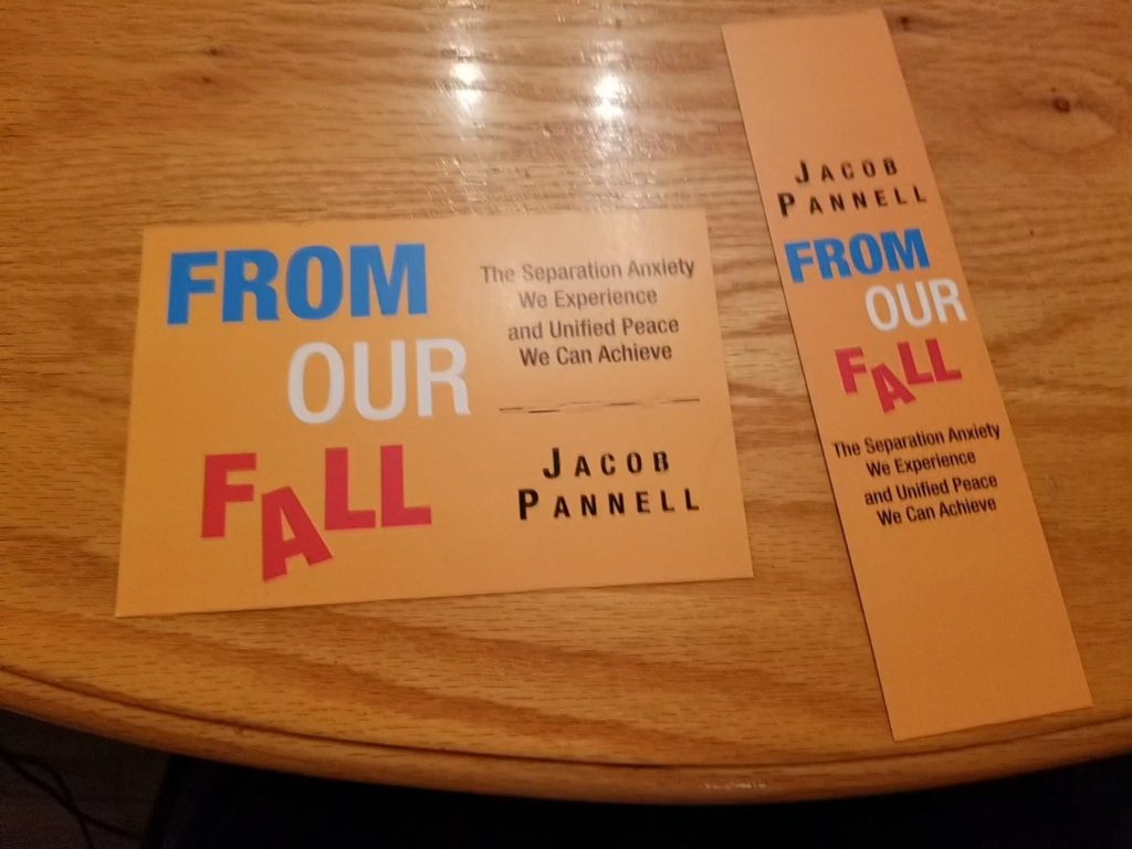 I picture of a postcard and a bookmark matching the cover of my book.