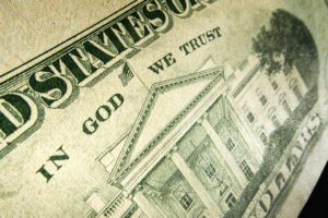 """Picture of a 20 dollar bill with the words """"In God we Trust"""" highlighted"""