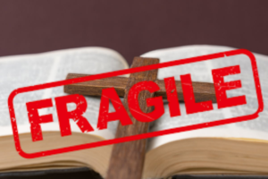 PIcture of a Bible with a Fragile sticker on it